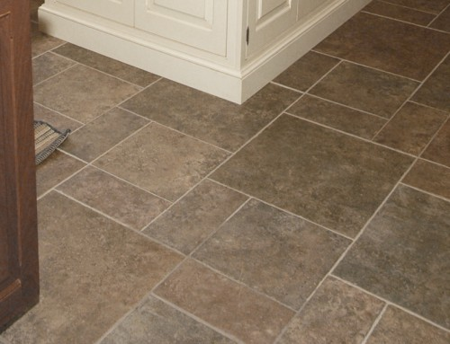 Removal of oil or wax from stone tiles